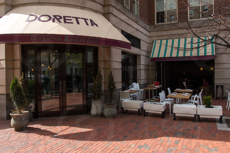 doretta store and brown and white tables and chairs outside during daytime photo