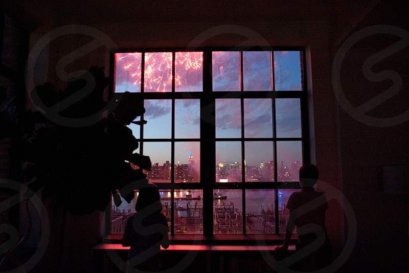 New York City view with Fireworks from home interior photo