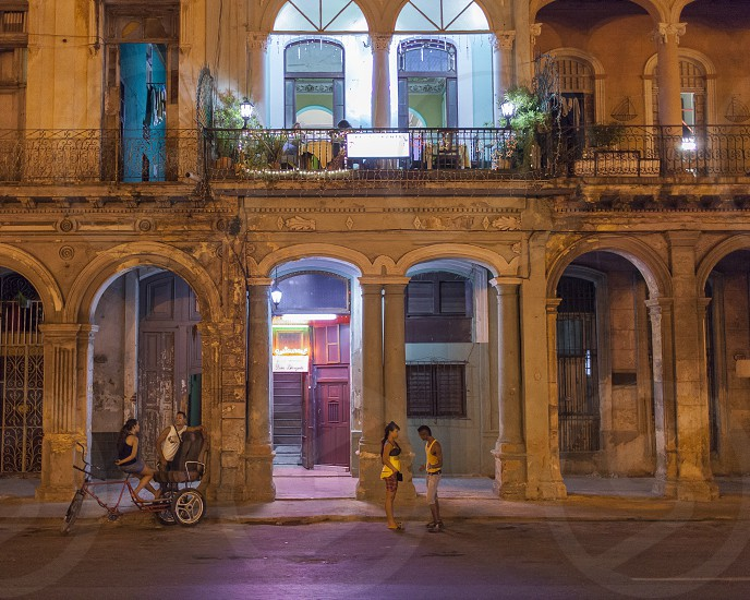 street talk restaurant night home bike cuba havana photo
