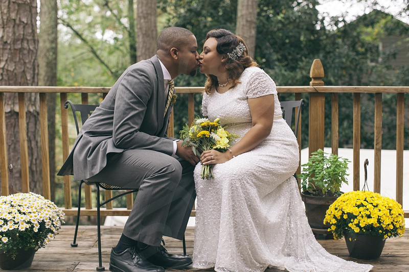 photo of wedding couple kissing during daytime photo