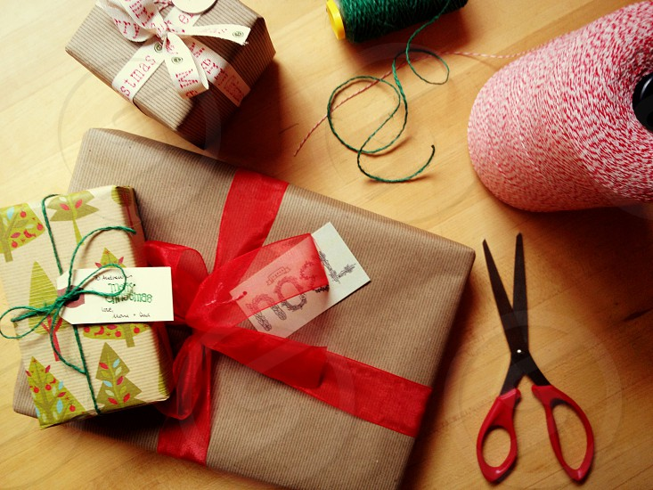 Christmas packages wrapped packages gifts holiday gifts ribbon string photo
