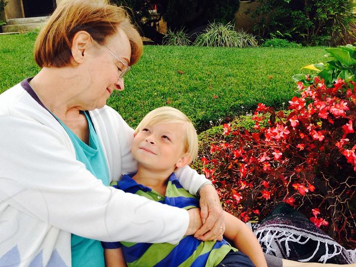woman holding boy both smiling photo
