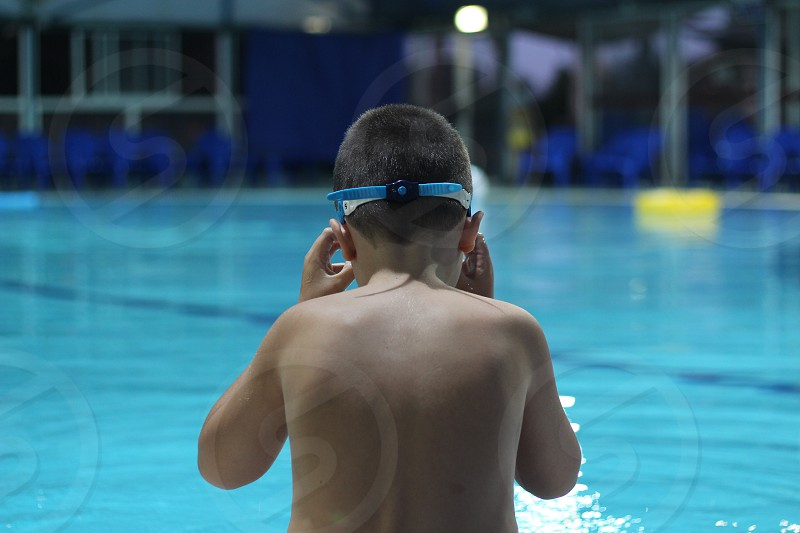 boy in goggles at the swimming pool photo
