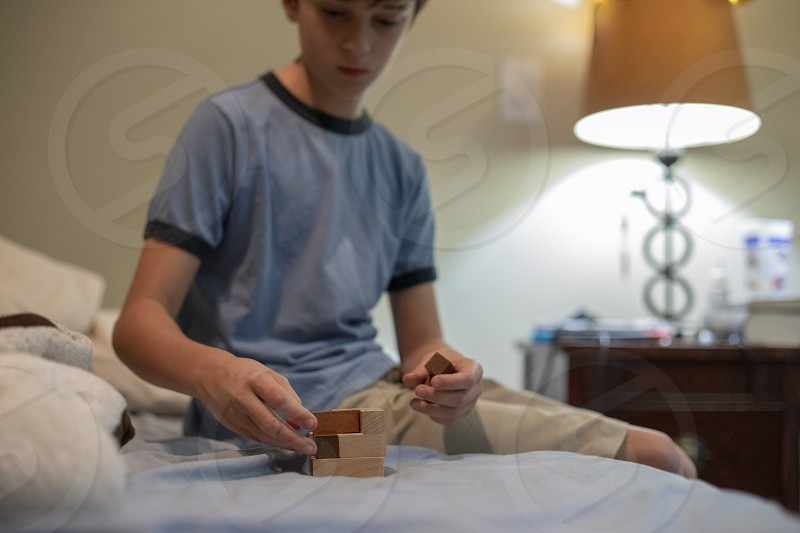 Boy plays with puzzle blocks photo
