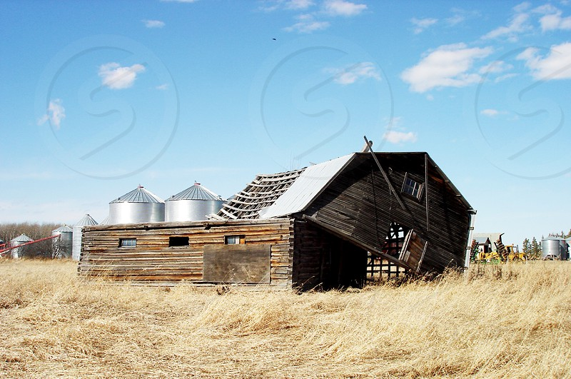 An old barn is cut in half by storm photo