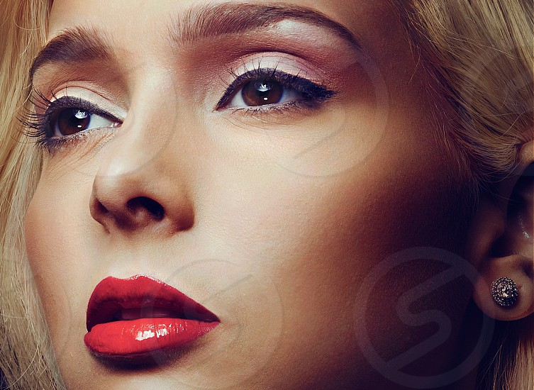 woman with blonde hair wearing red lipstick photo