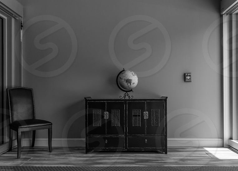 entry chair cabinet globe black and white photo