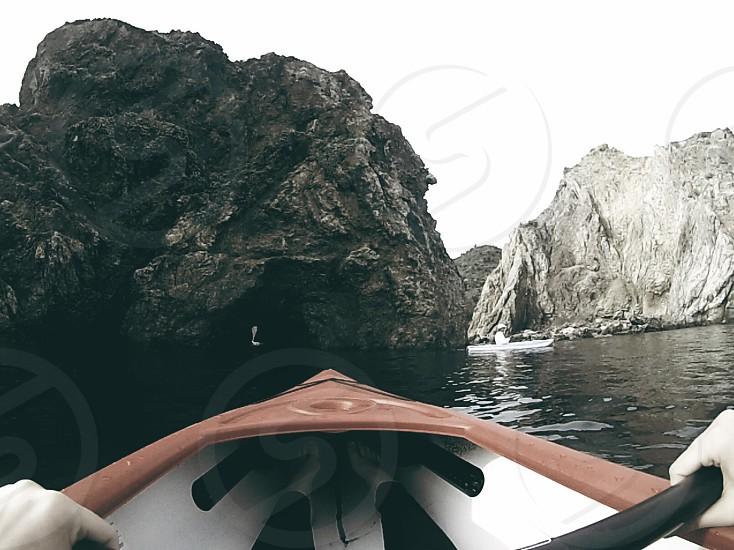 grey cave and lake view photo