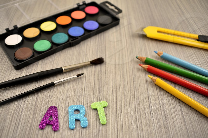 Art supplies. Back to school. Art supplies on a wooden background. School supplies for painting photo