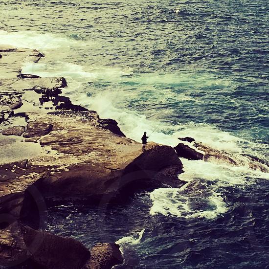 Lone fisherman Bondi Beach trail Australia photo