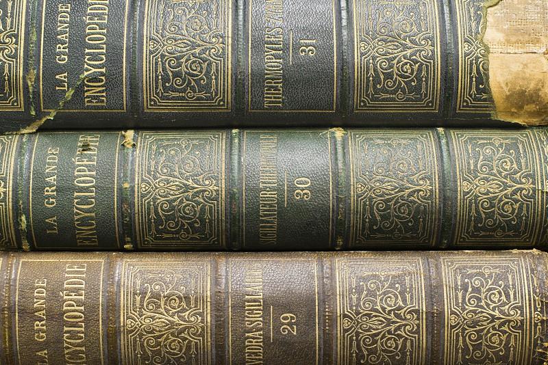 Old books on shelf. French encyclopedia. Close up shot photo