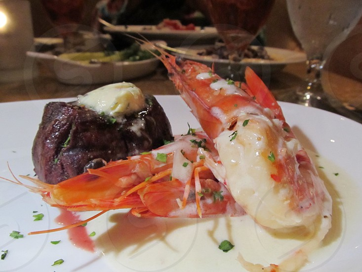 Whole red shrimp and steak with butter photo