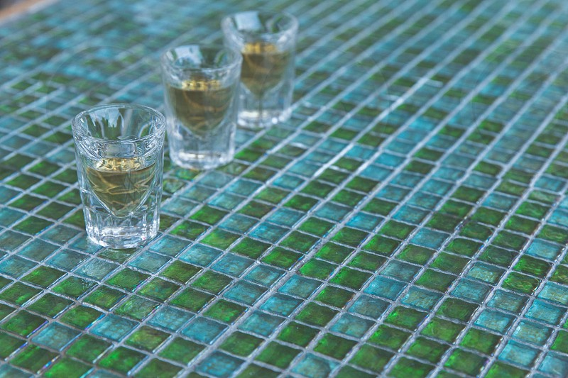 Tequila shots lined up on a bar counter photo