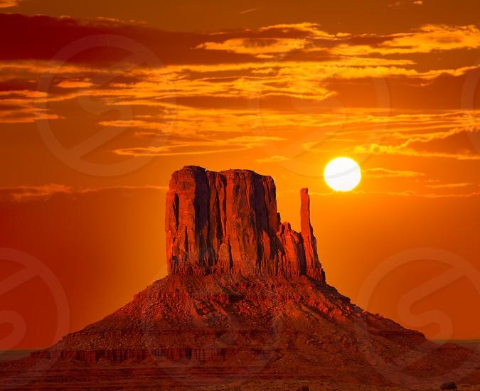 Monument Valley West Mitten at sunrise sun orange sky Utah photo mount photo