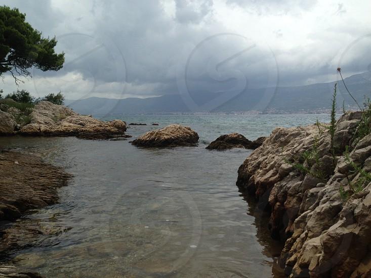 Rocks and sea in Split Croatia photo