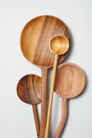 different kitchen wooden utensils on a white background on a white background photo