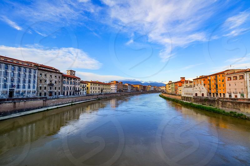 Scenic landscape of the Arno river in Pisa with the church of Santa Maria della Spina photo