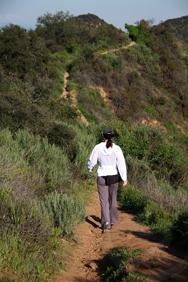 Athletic woman hiking along a trail photo