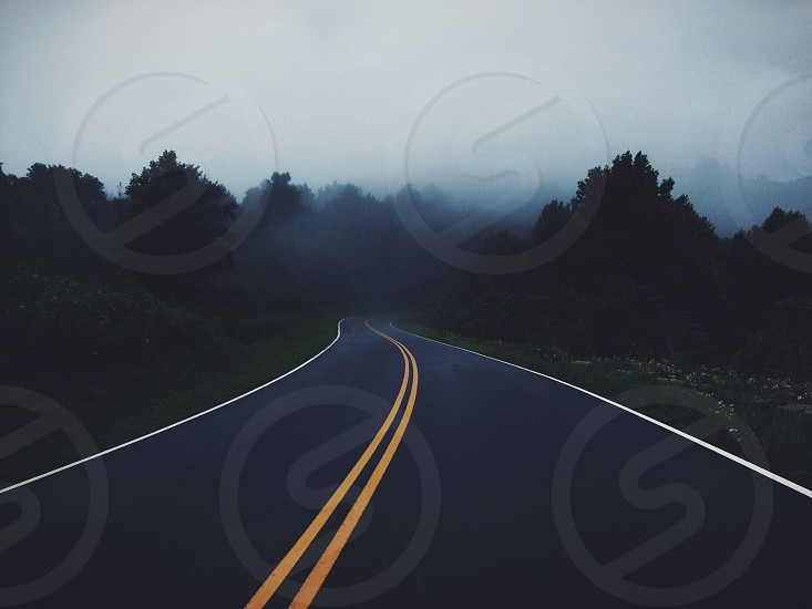 black asphalt road with yellow and white lines photo