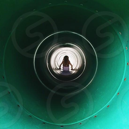 girl in white tank top in slide photo