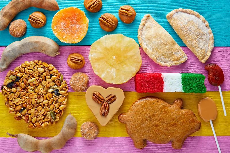 Mexican sweets and pastries cajeta tamarindo coconut flag Palanqueta puerquito photo