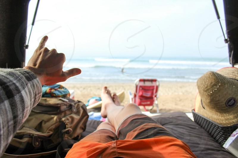 Perspective person legs beach ocean California relax  photo