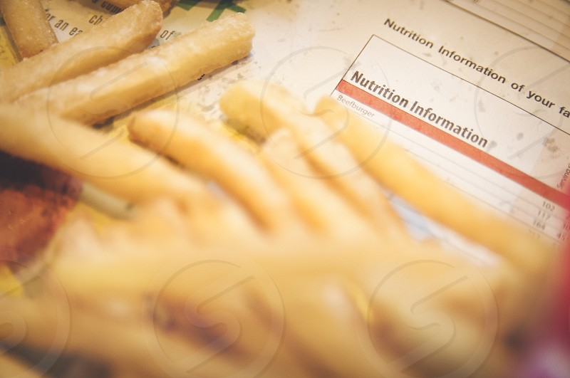 Closeup of french fries with nutrition information text photo