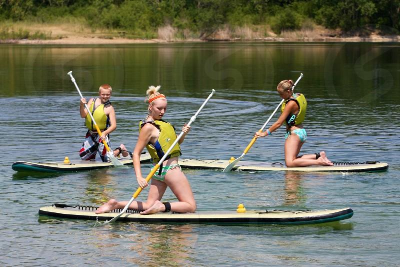women in canoe on lake photo