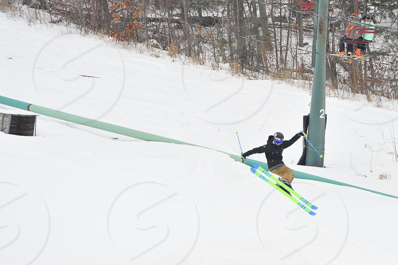 Snow skier jumping photo