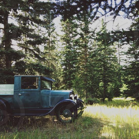 green vintage 1920s pickup truck photo