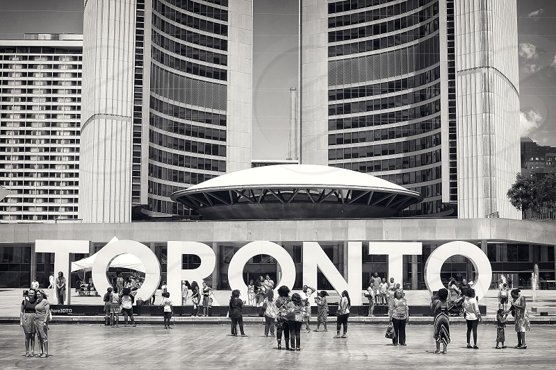 Toronto sign and city hall ay Nathan Phillips Square in Toronto. photo