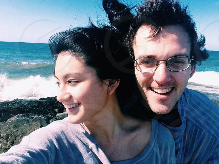 woman and man near the beach shore photo
