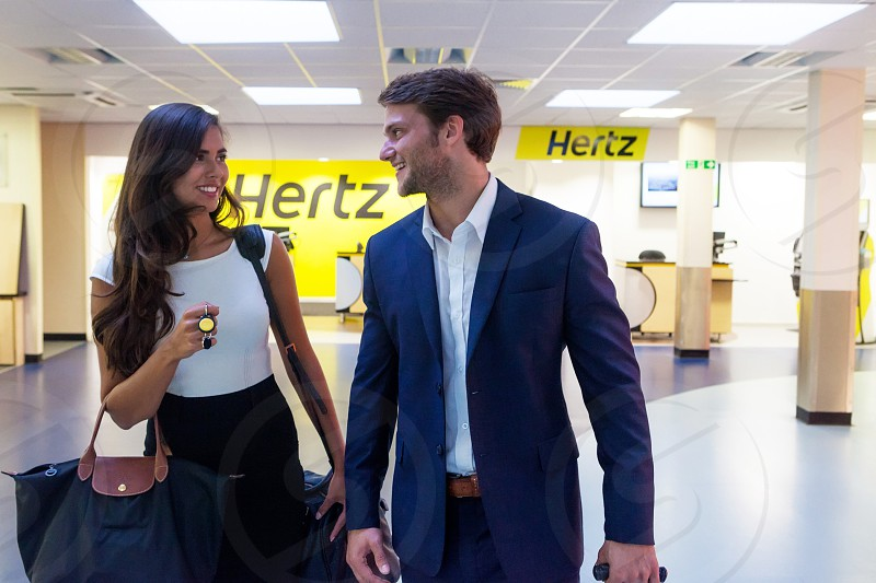 a family travel arrival in the airport with a hertz company manufature  photo