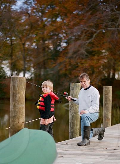 Fishing little boy grandson grandfatherfamily water fun river photo