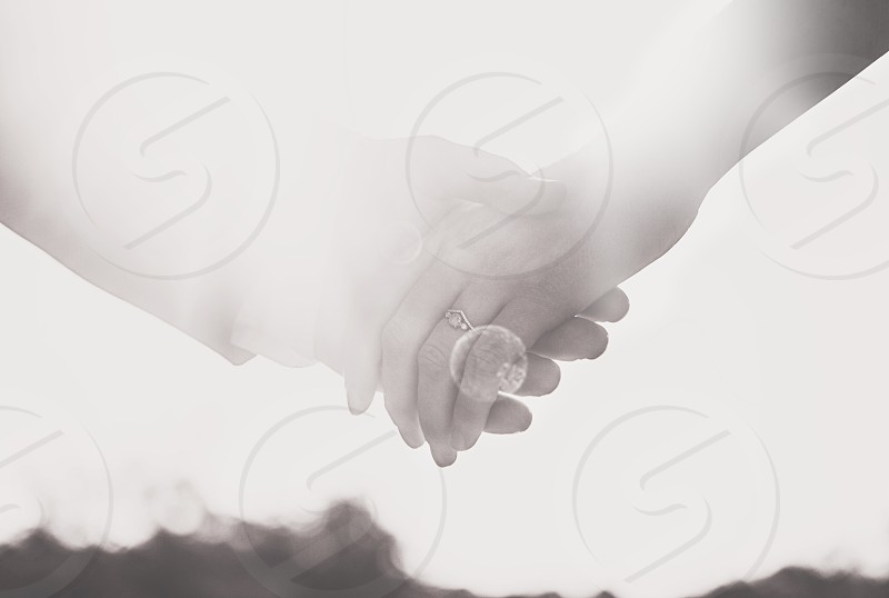 hands couple man woman ring black white black and white lens flare photo