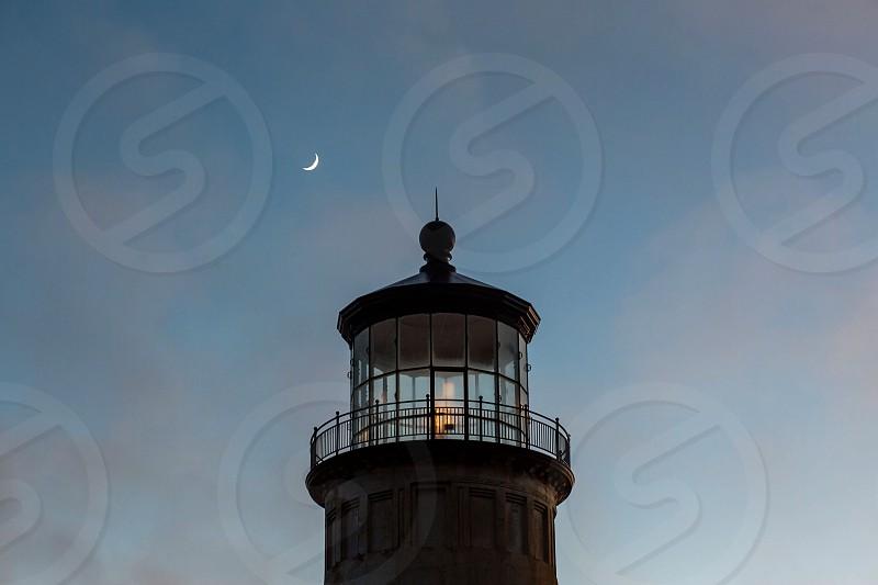 lighthouse moon crescent crescent moon dusk coast sunset historical coastal west coast photo