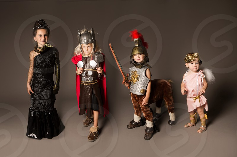 Mythology themed kids costumes - Medusa Thor Centaur and a cherub. photo