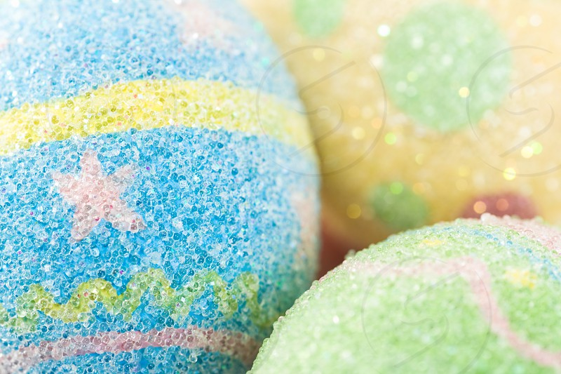 Three pastel colored Easter Eggs up close and abstract.  photo