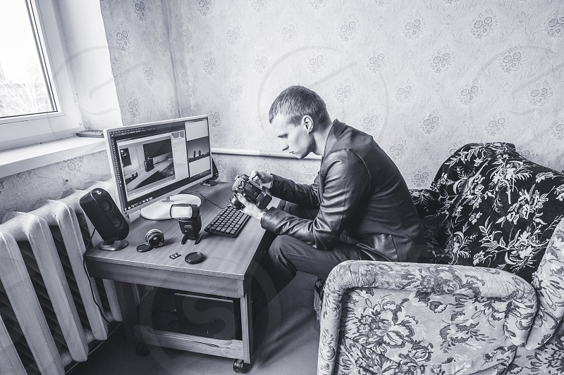 photographer at work post production editing edit retouch photo after photoshoot home own studio young pro photo