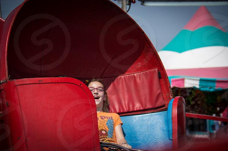 girl riding amusement ride photo