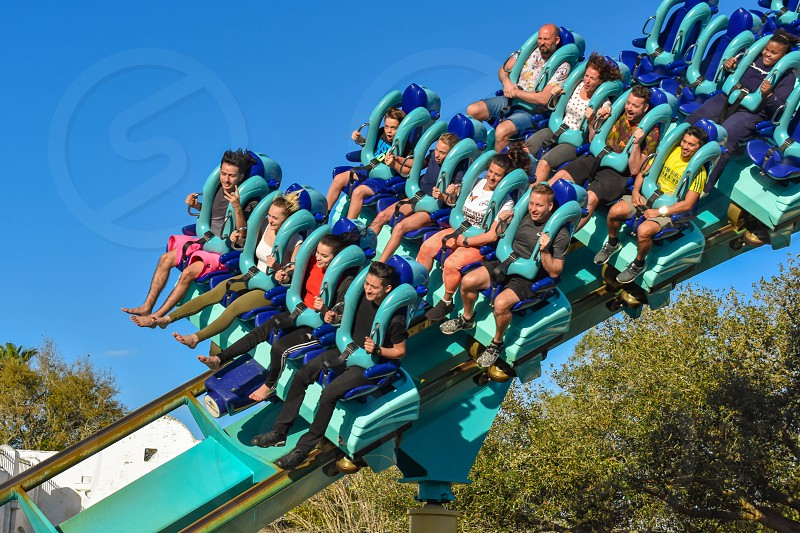 Orlando Florida . February 26  2019.  People enjoying terrific Kraken rollercoaster at Seaworld Theme Park (12) photo