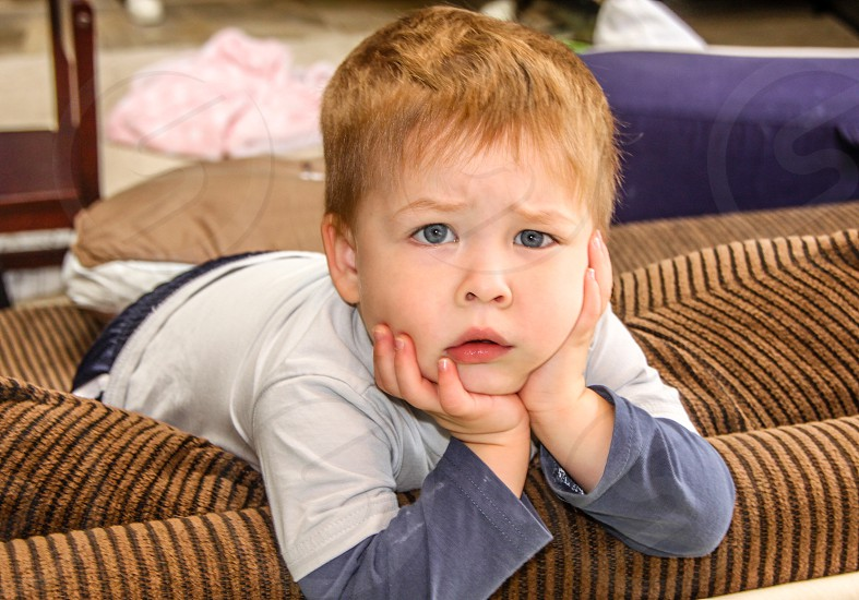 Young boy with exasperated look photo