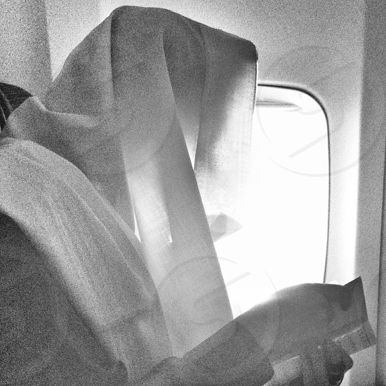 A passenger reading his sacred text photo