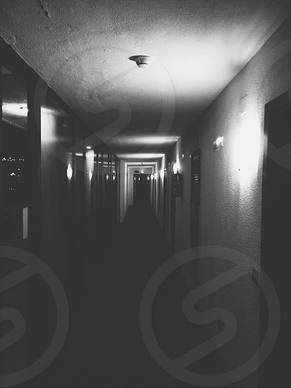 grayscale photography of hallway photo