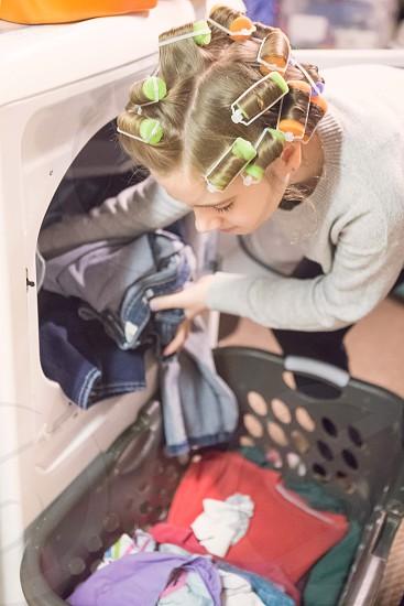 Girl doing laundry  photo