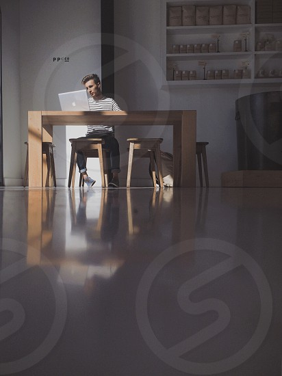 Guy in front of a laptop photo