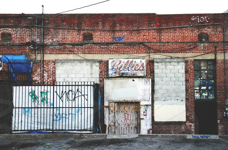 billie's store sign on an orange brick building photo
