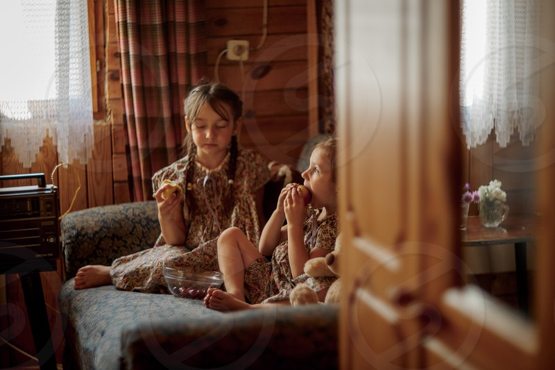 Little sisters and old radio indoor portrait in retro style  photo