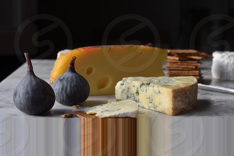 Selection of cheese and biscuits on a marble work surface. photo