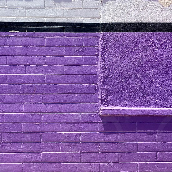 Purple brick wall photo
